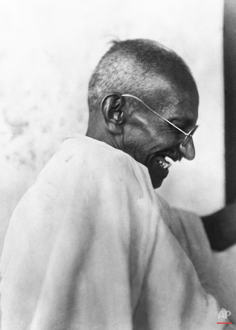 Gandhi changing the world...and laughing, in 1923 (AP Photo)